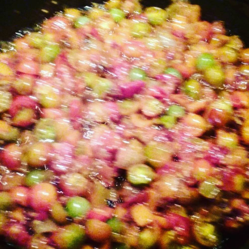 Sautéing the grape tomatoes & garlic along with peppers & onions